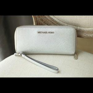 Michael Kors Large travel wallet w/wristlet.